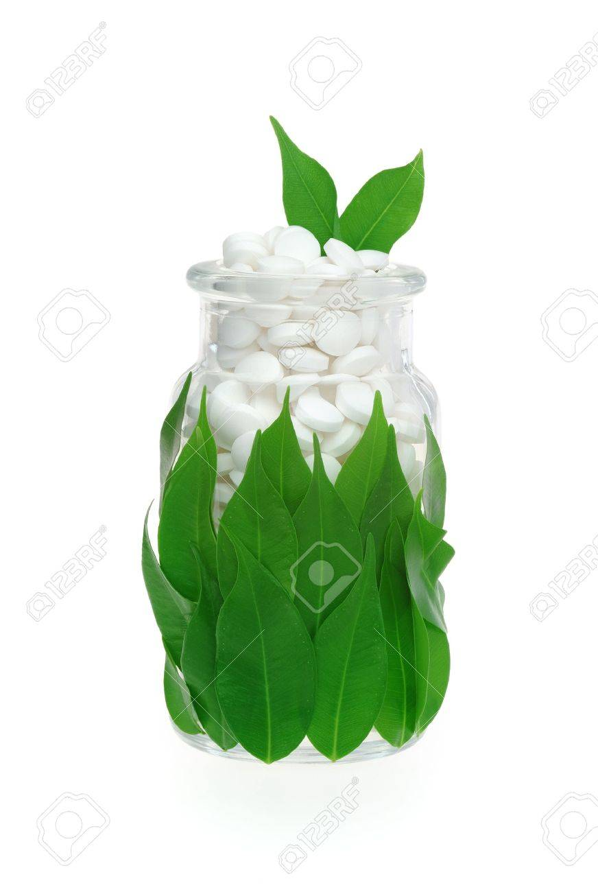 Herbal supplement pills and fresh leaves in glass � alternative medicine concept Stock Photo - 12576726