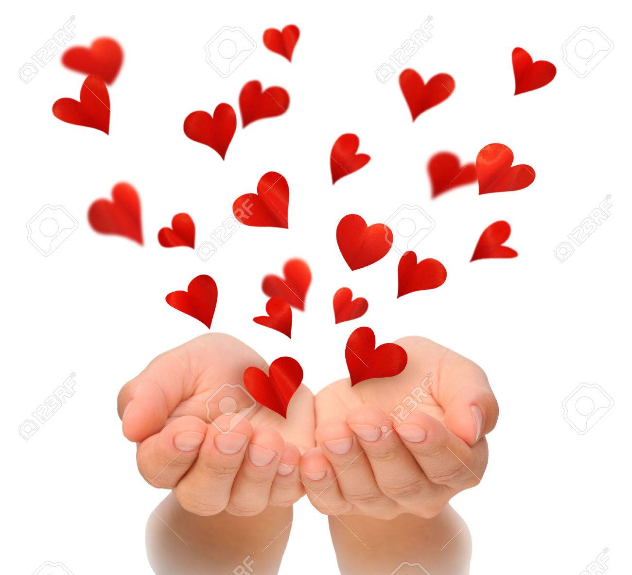 flying hearts from cupped hands of young woman valentine u0027s day