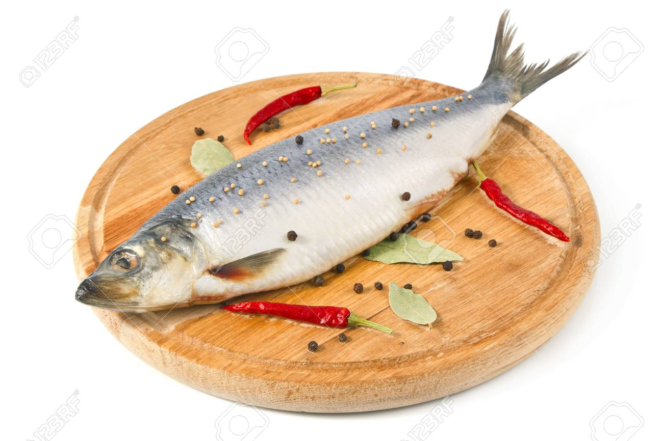 herring on wooden hardboard with spice isolated white background Stock Photo - 12390904