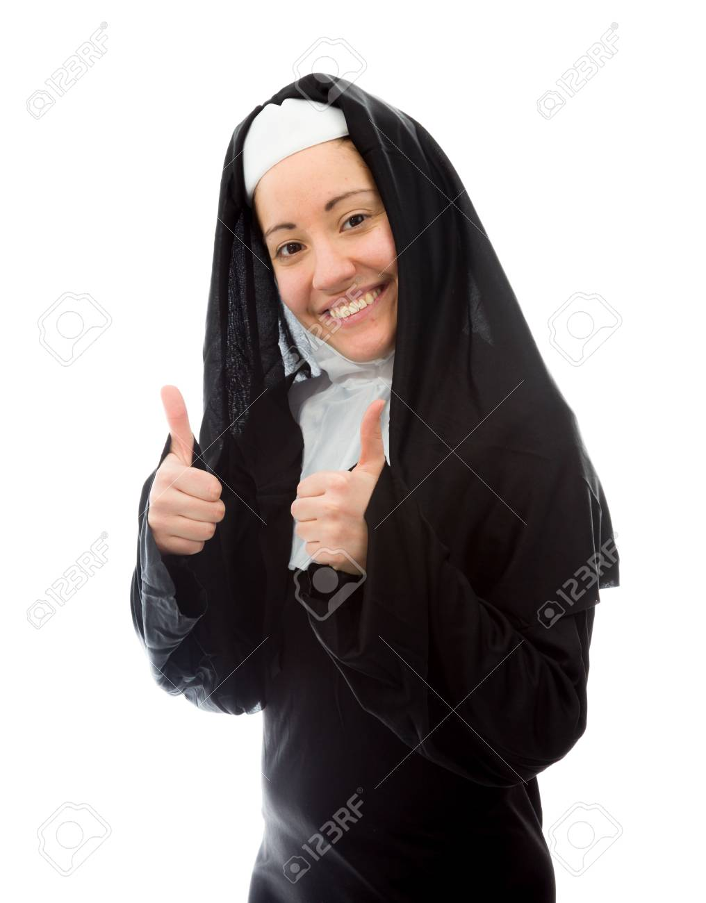 Young nun showing thumbs up sign with both hands Stock Photo - 29447927