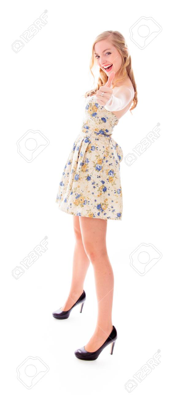 Beautiful young woman standing and showing thumbs up sign Stock Photo - 29483201