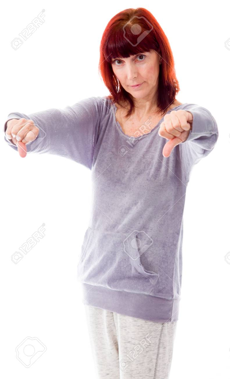 mature woman showing thumbs down sign from both hands stock photo