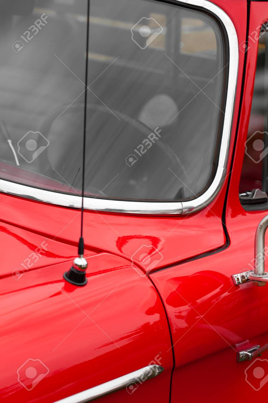Close Up Of Car Antenna Of A Red Shiny Classic Vintage Car Stock