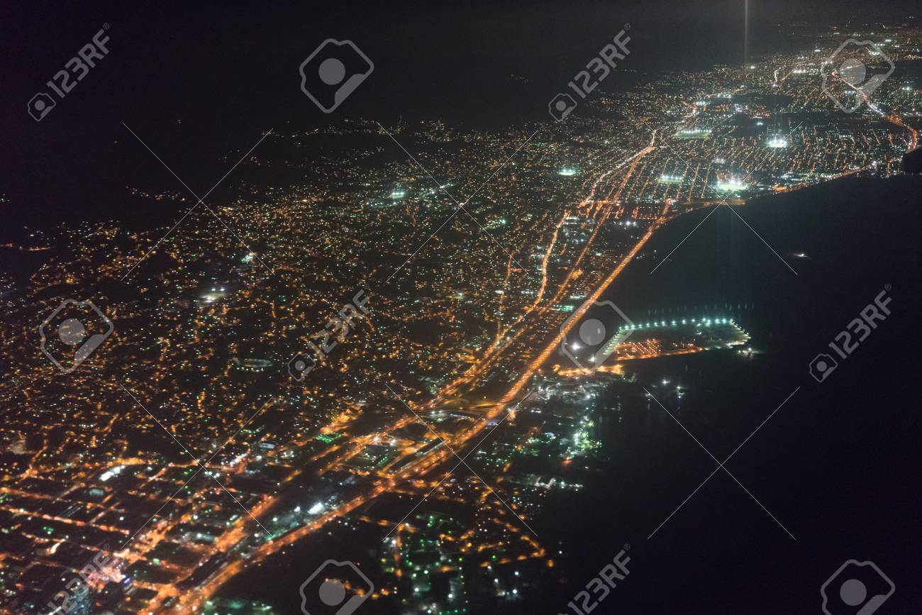 Aerial View Of Illuminated City Seen Through Airplane At Night Trinidad And Tobago