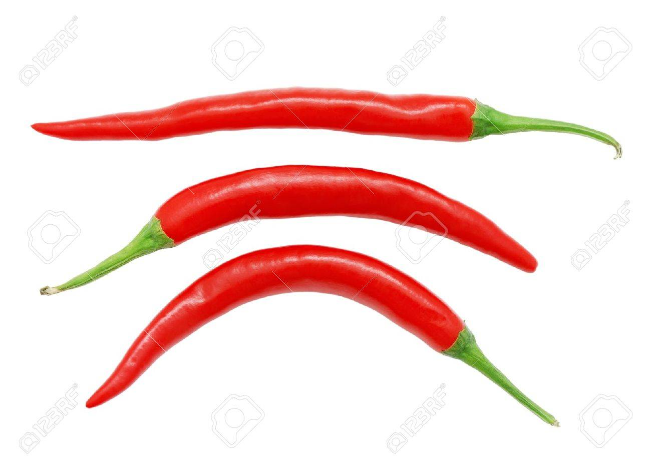 Three red hot chili peppers isolated on white background Stock Photo - 10676596