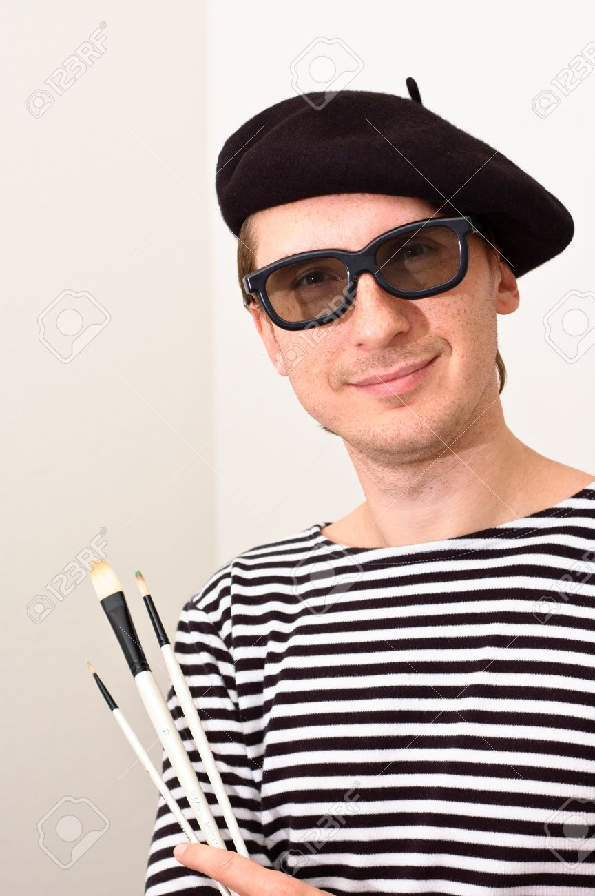 French artist in beret with three brushes Stock Photo - 12885400