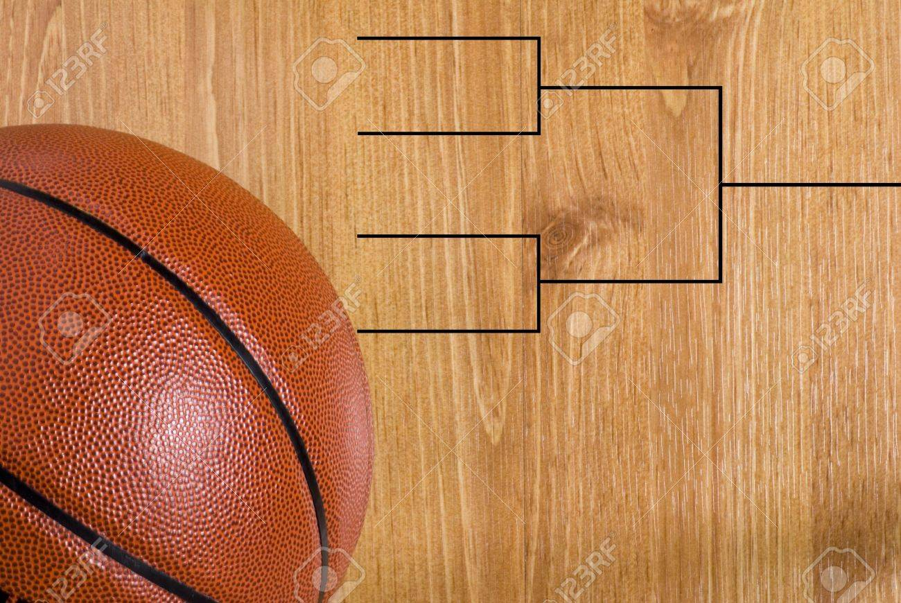 A final four bracket on a basketball floor and a ball Stock Photo - 12421222