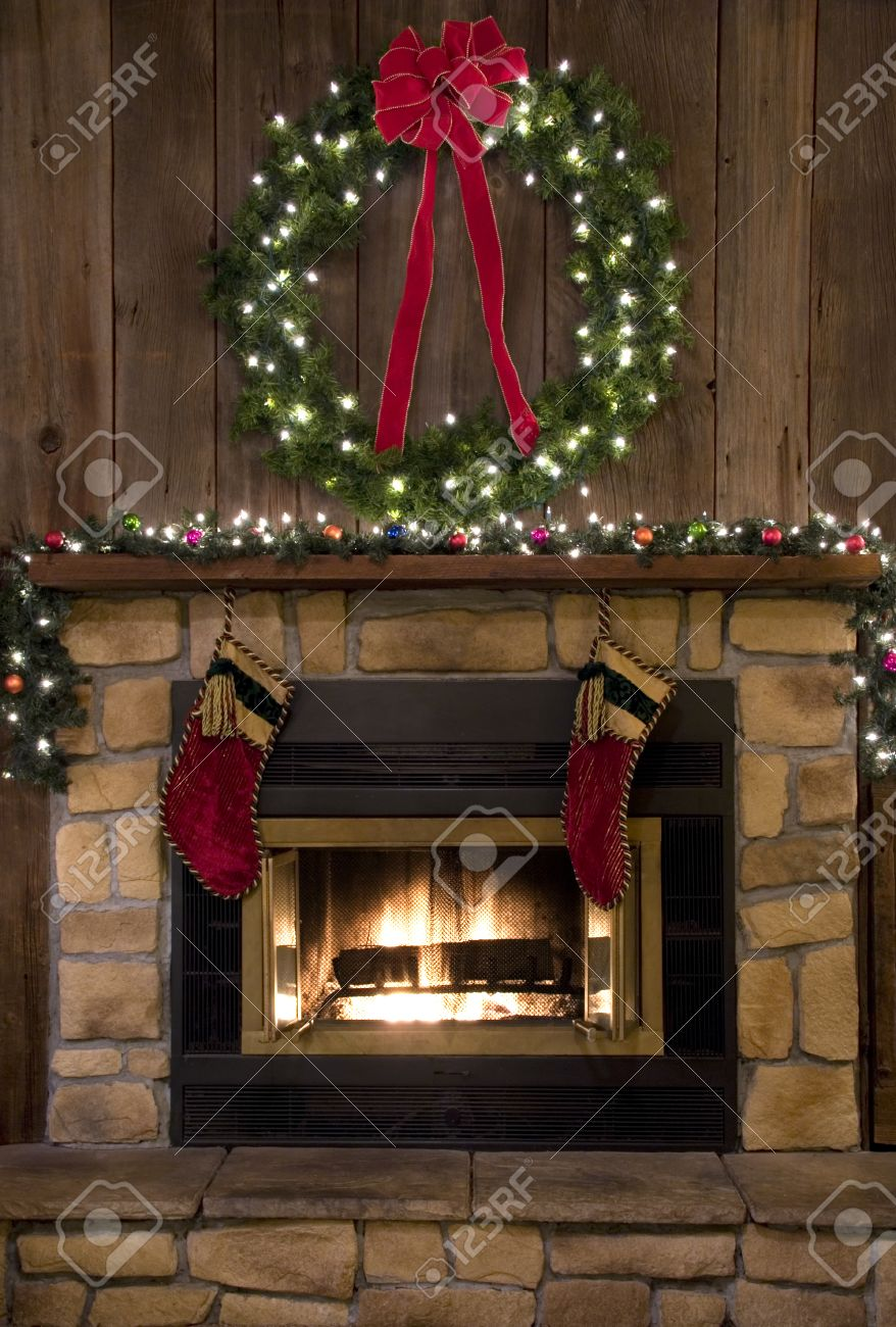 two christmas stockings hanging by the fireplace stock photo