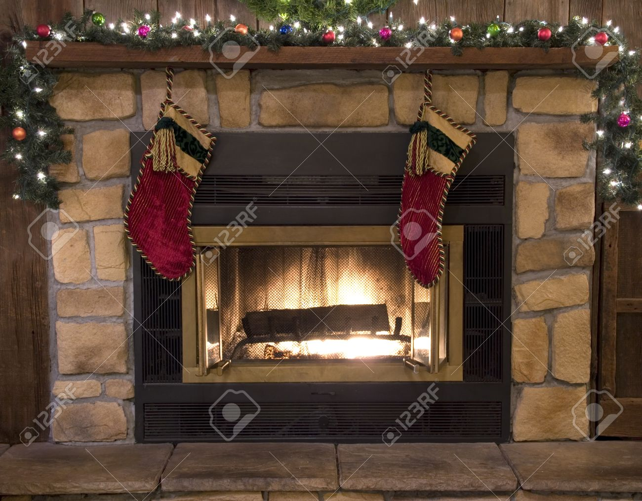 Christmas Hearth.Christmas Stockings Hanging Over The Fireplace Hearth