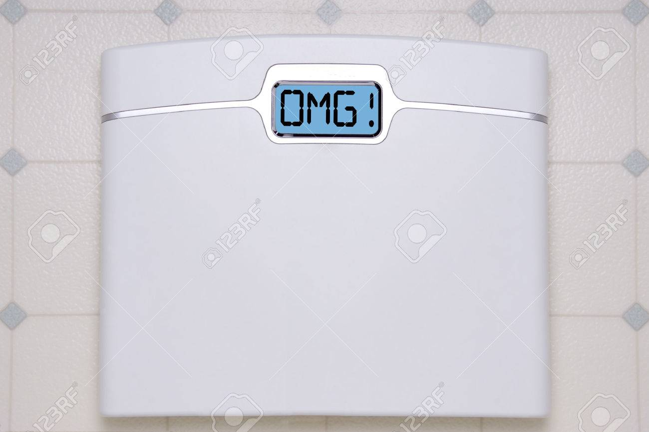 A White Digital Bathroom Scale Displaying The Text Message Omg Stock Photo 27935373