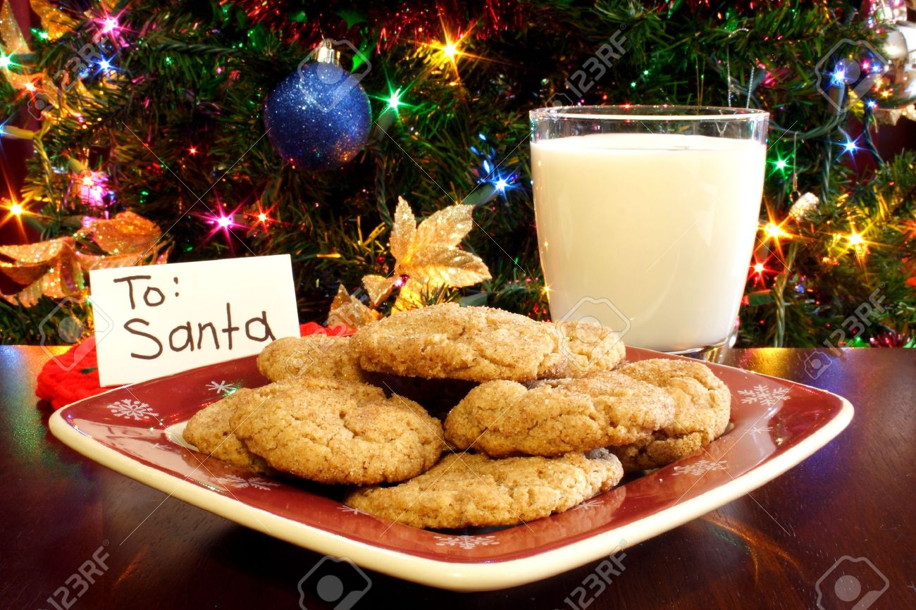 A Plate Of Cookies And A Glass Of Milk In Front Of A Christmas ...