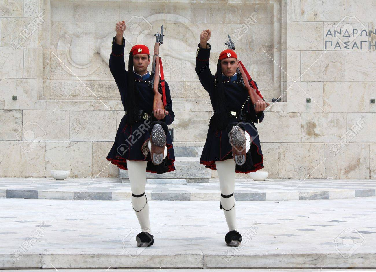 Athens, Greece - April 21, 2009: Evzones (presidential ceremonial guards) in front of the Unknown Soldier's Tomb at the Greek Parliament Building in Athens, opposite Syntagma Square. Stock Photo - 6886552