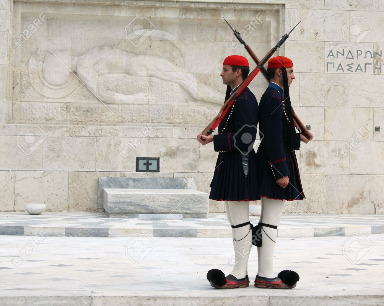 Athens, Greece - April 21, 2009: Evzones (palace ceremonial guards) in front of the Unknown Soldier's Tomb at the Greek Parliament Building in Athens, opposite Syntagma Square. Evzones guard the Tomb of the Unknown Soldier, the Hellenic Parliament and the Stock Photo - 6887642