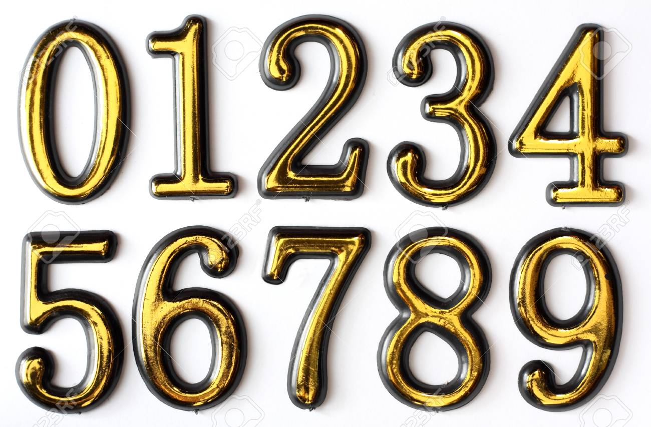 Golden bright numbers on a white background. Stock Photo - 8677316