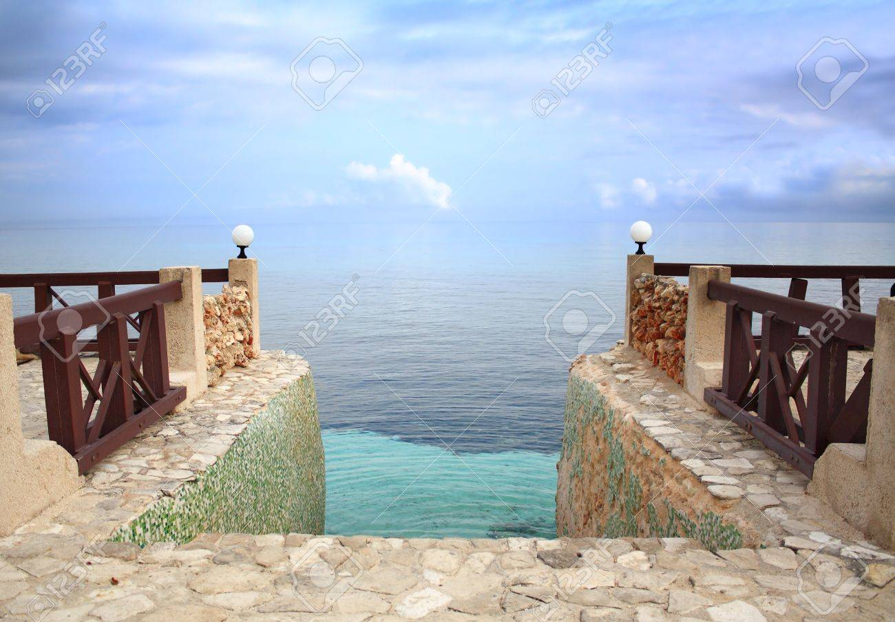 Steps leading into the Caribbean Sea, merging with the sky, at dusk. Stock Photo - 10332803