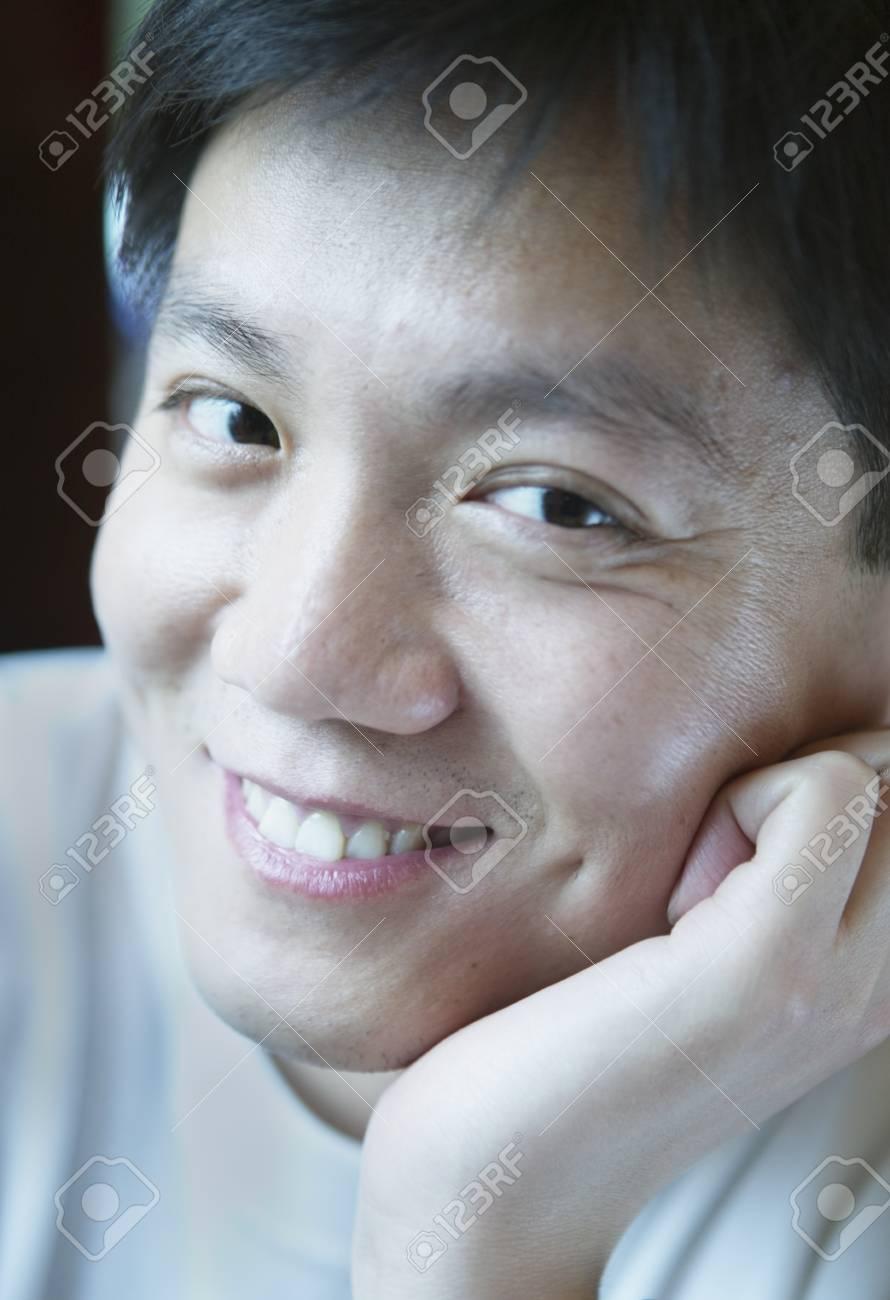 Close-up of a man looking at camera smiling, Beijing , China Stock Photo - 16043353