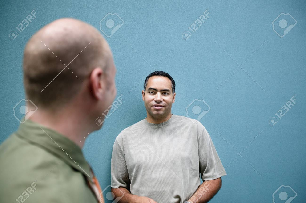Two businessmen talking to each other Stock Photo - 16043914