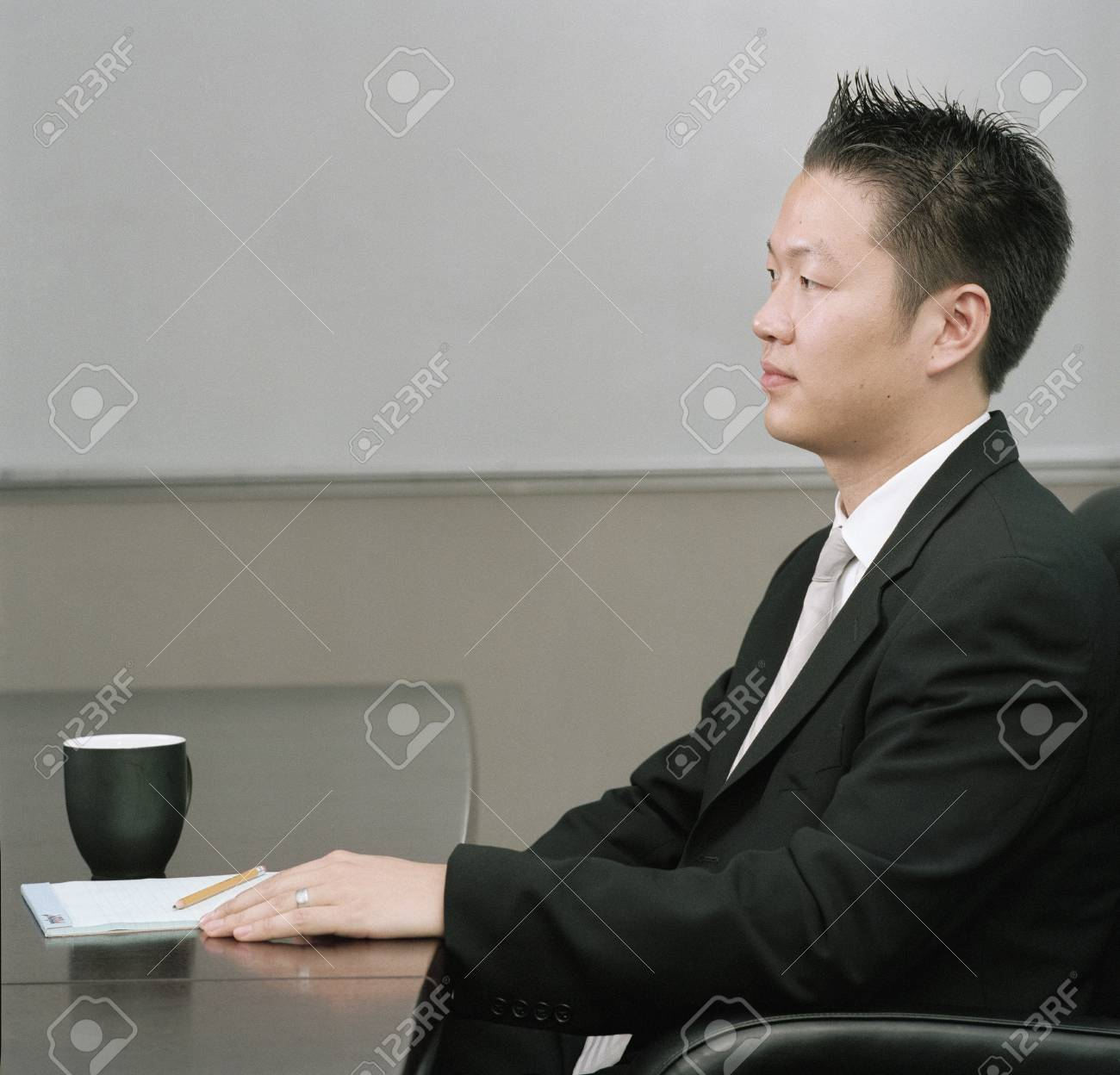 Young man sitting at a desk in a meeting Stock Photo - 16044179