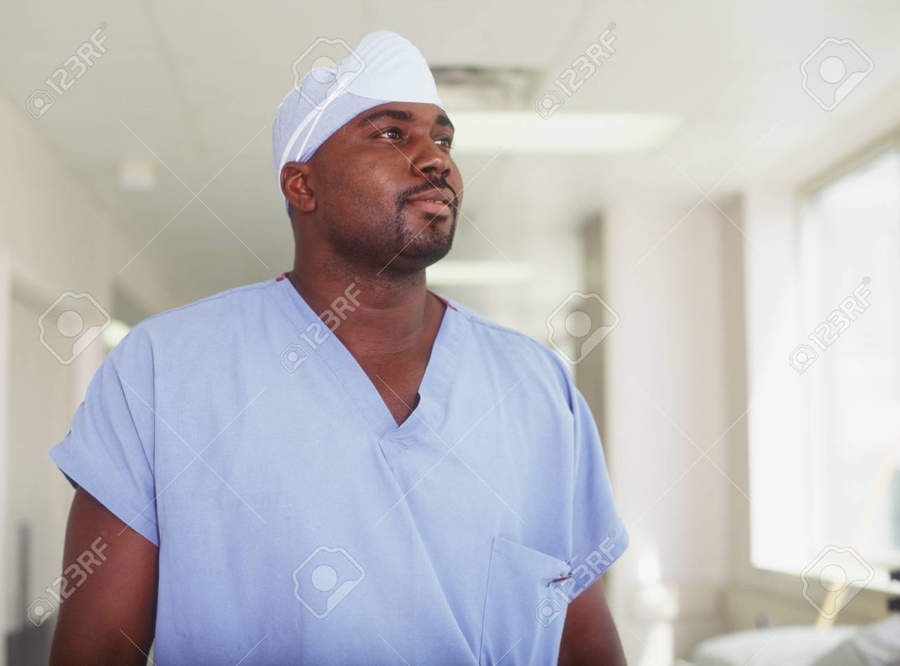 Male surgeon standing in a hospital corridor Stock Photo - 16044323