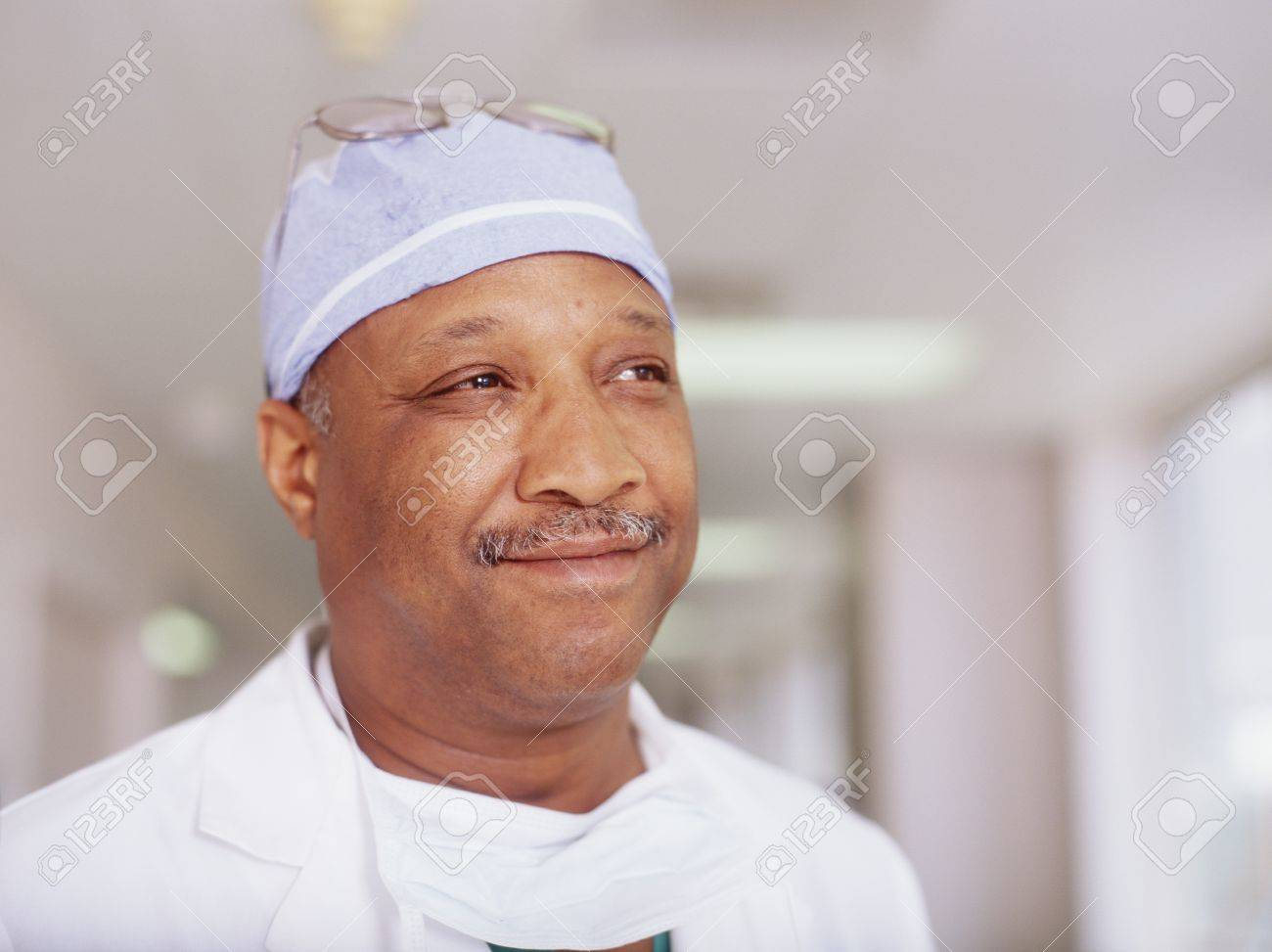 Portrait of a male doctor smiling Stock Photo - 16044345