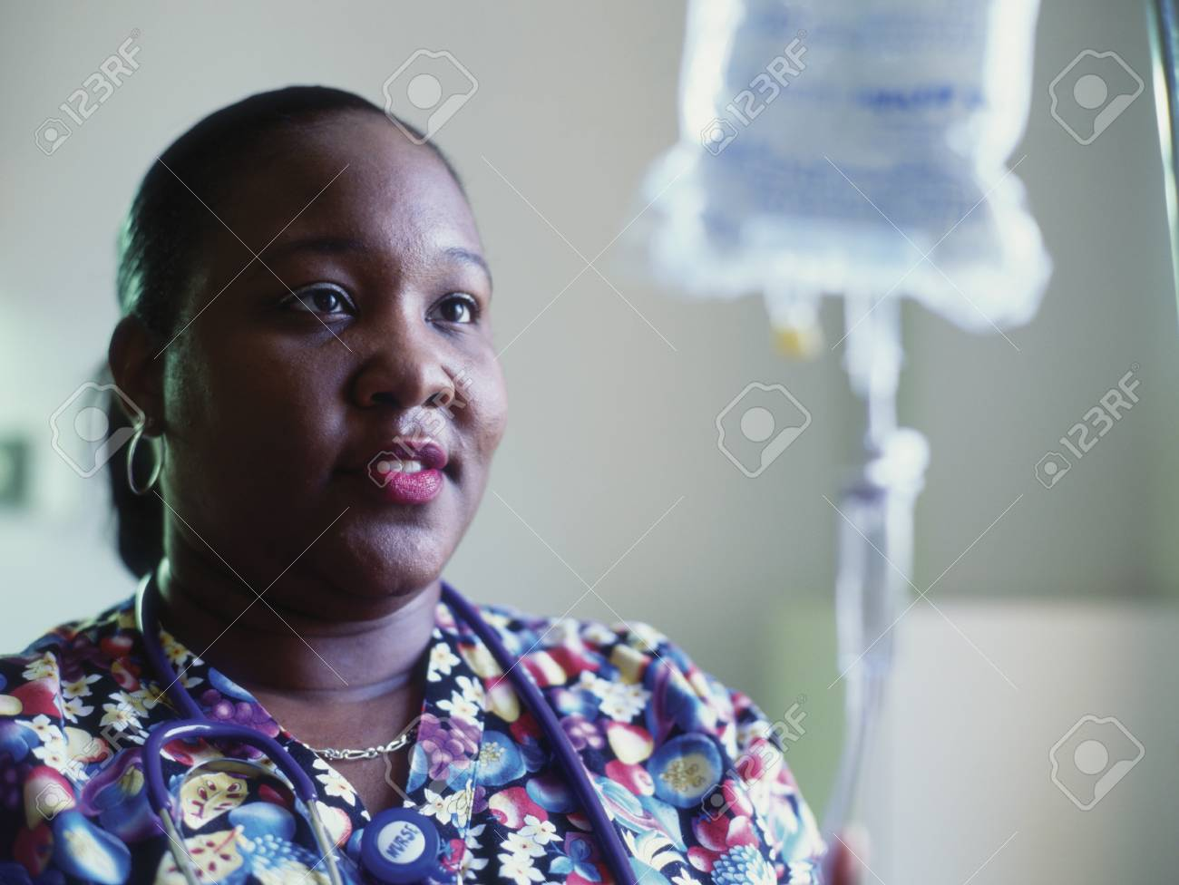 Female nurse adjusting a drip Stock Photo - 16044362
