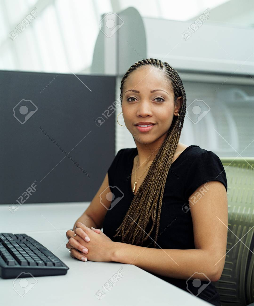 Portrait of young woman sitting Stock Photo - 16044691