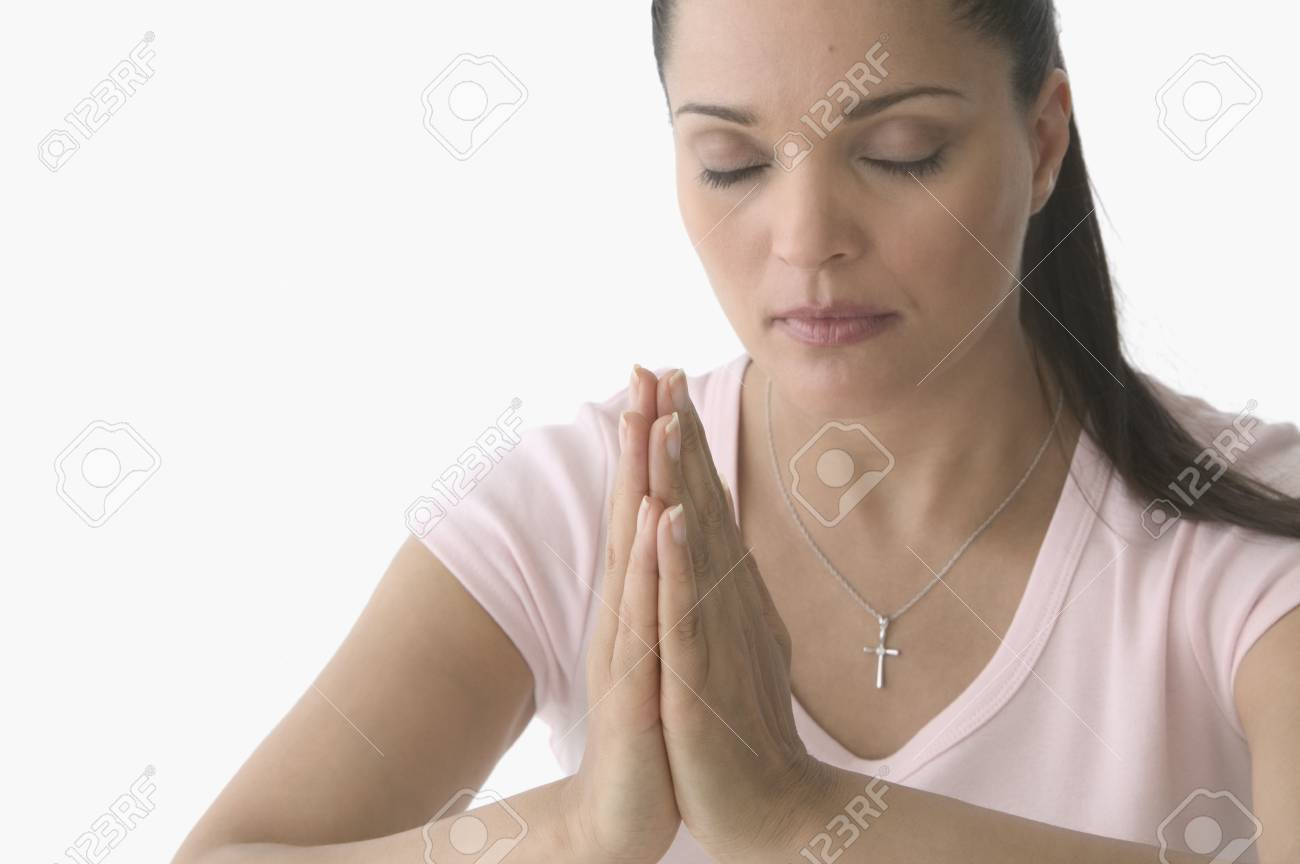 Mid adult woman praying Stock Photo - 16045013