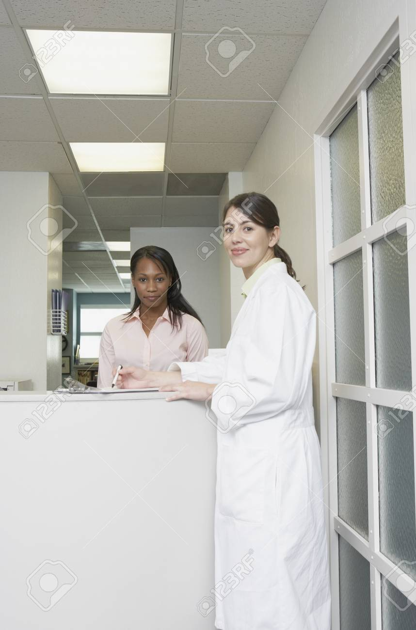 Portrait of a female doctor standing in front of a young woman Stock Photo - 16046312