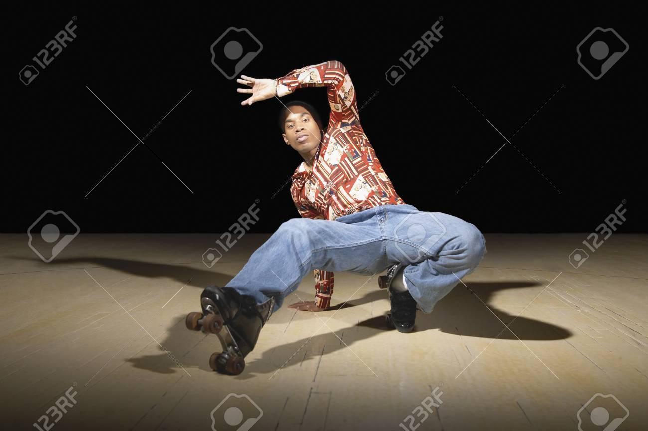 Roller skates dance - Stock Photo Young Man Break Dancing On Roller Skates