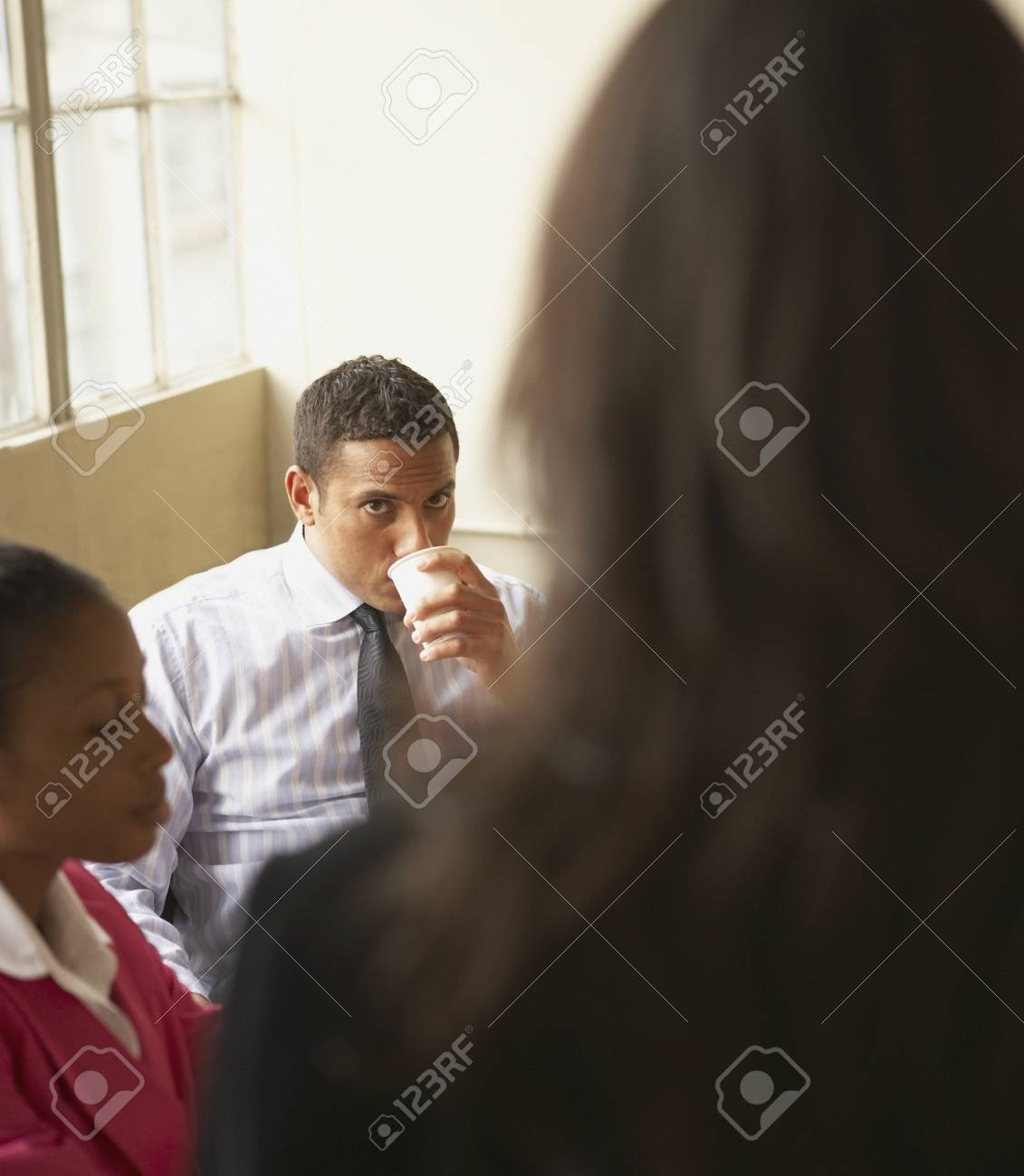 Businessman drinking coffee in an office Stock Photo - 16047281