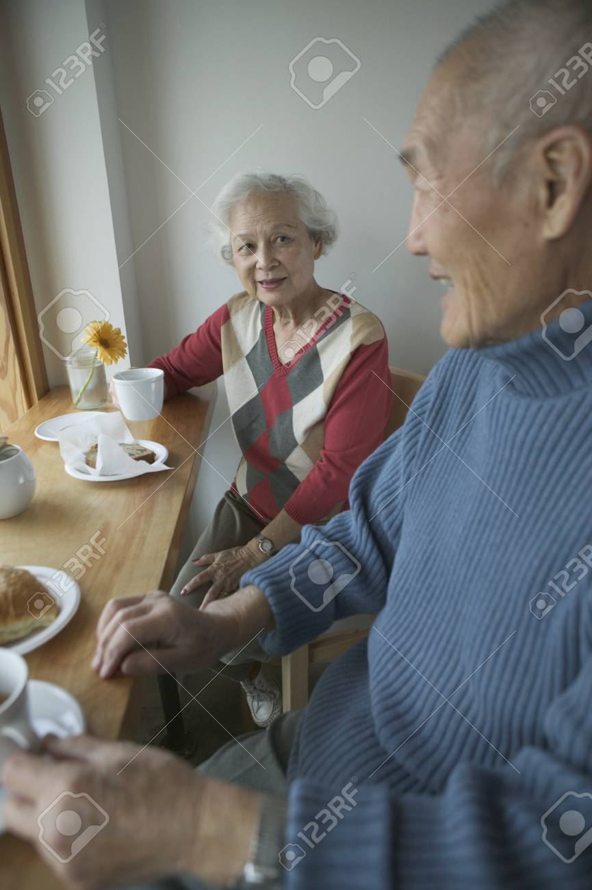 Senior couple sitting together and having breakfast Stock Photo - 16047704