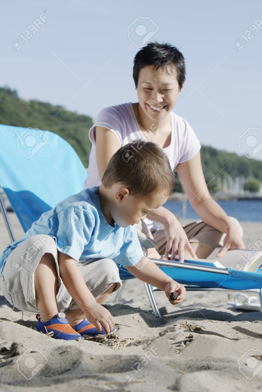 Mother and son at the beach Stock Photo - 16070443