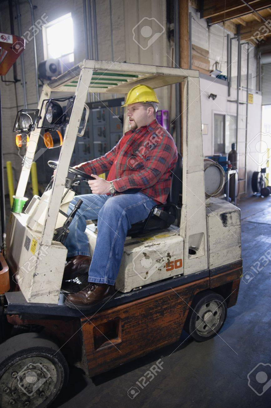 Man driving forklift in warehouse Stock Photo - 16070906