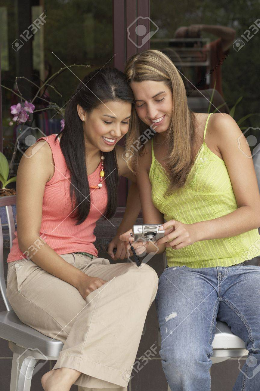 Two young women reviewing digital photos Stock Photo - 16071268