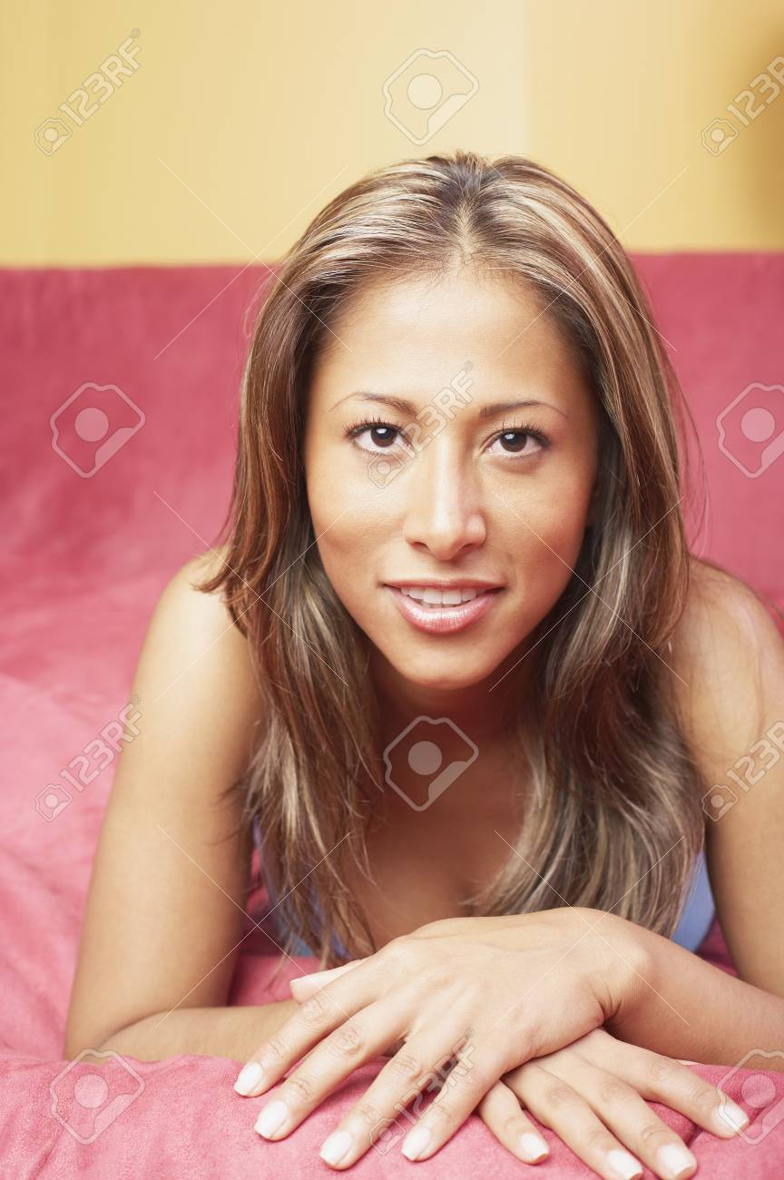 Portrait of woman lying on couch Stock Photo - 16071305