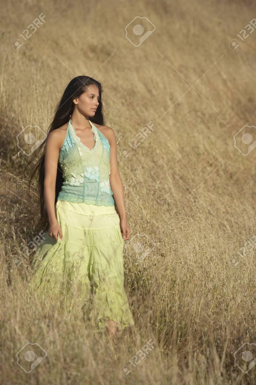 Woman walking among wild grasses Stock Photo - 16071375