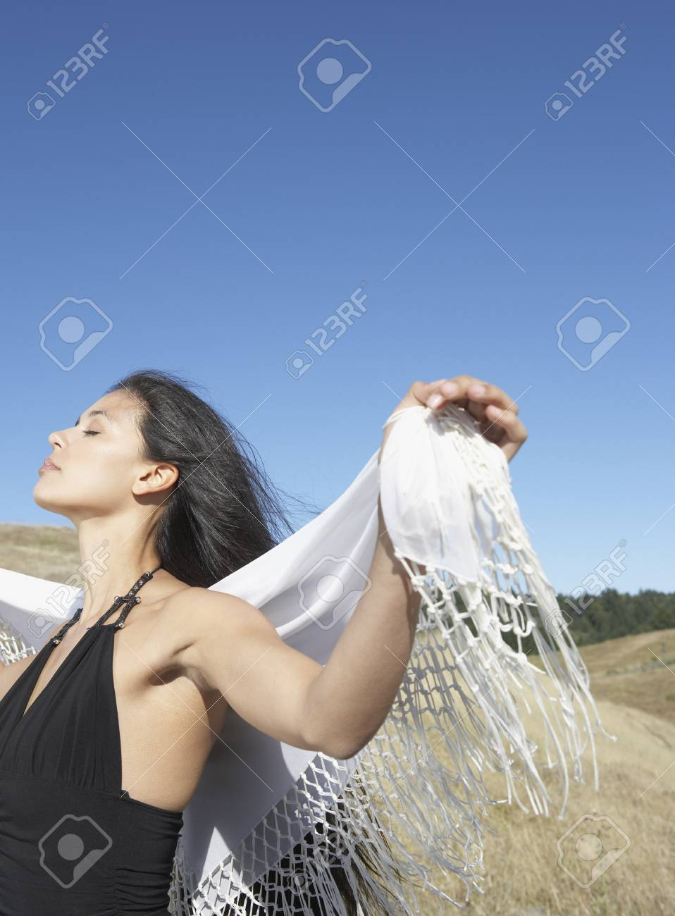 Sensual woman standing in countryside Stock Photo - 16071401
