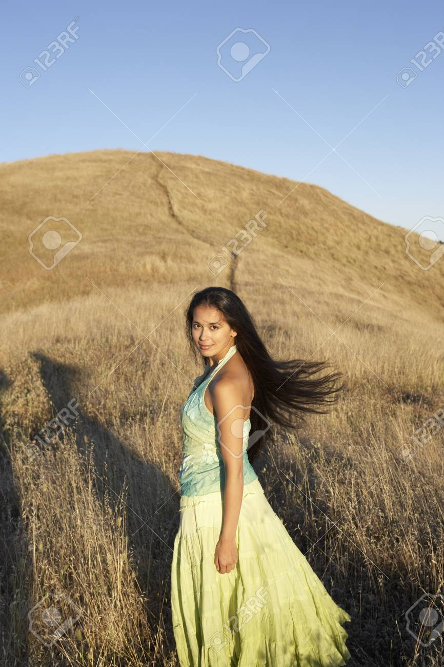 Woman standing in hilly country Stock Photo - 16071418