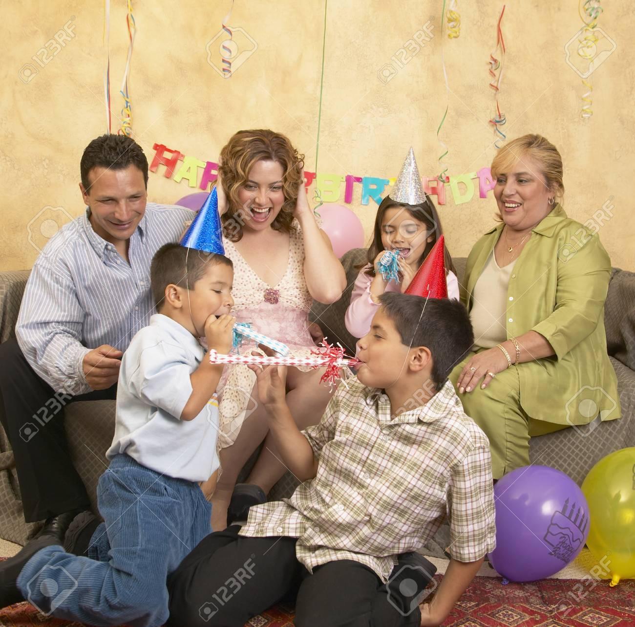 Family celebrating a birthday party Stock Photo - 16071624