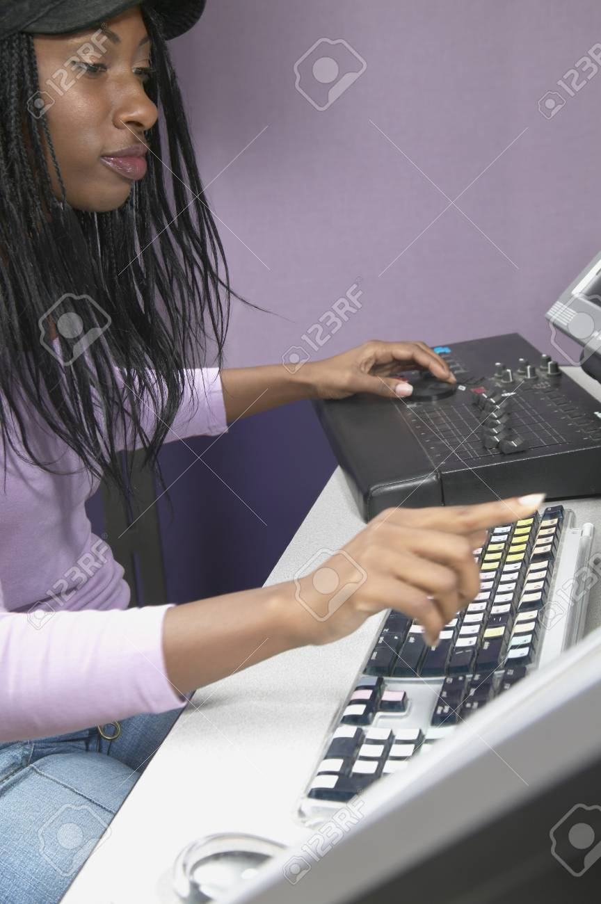 Young woman in a recording studio Stock Photo - 16071627