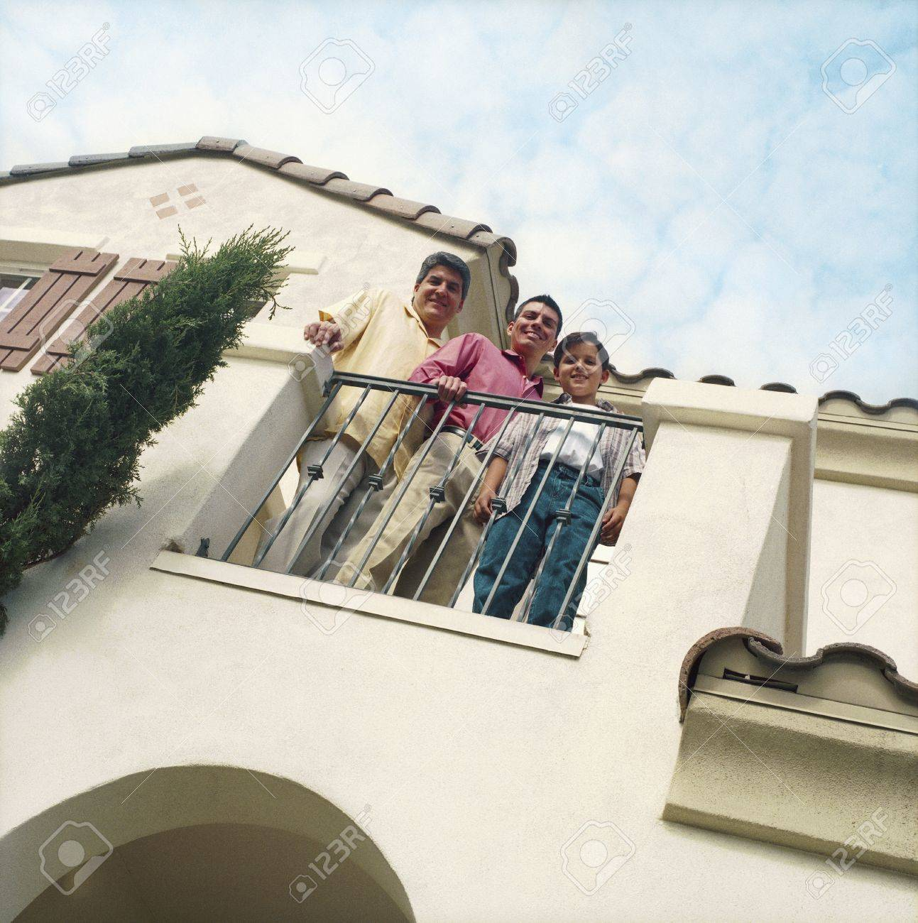 Three males standing on home balcony Stock Photo - 16071702
