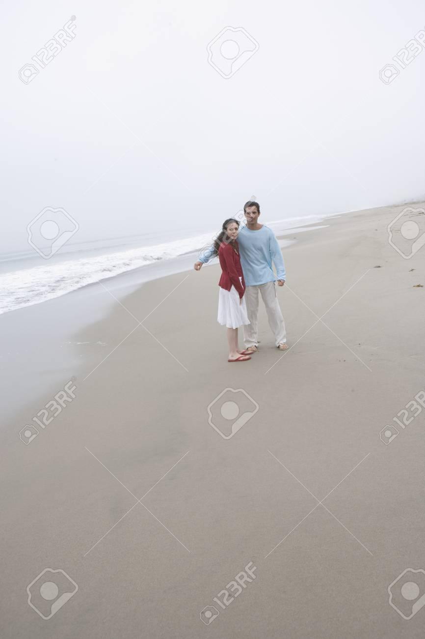 Couple posing on foggy beach Stock Photo - 16071741