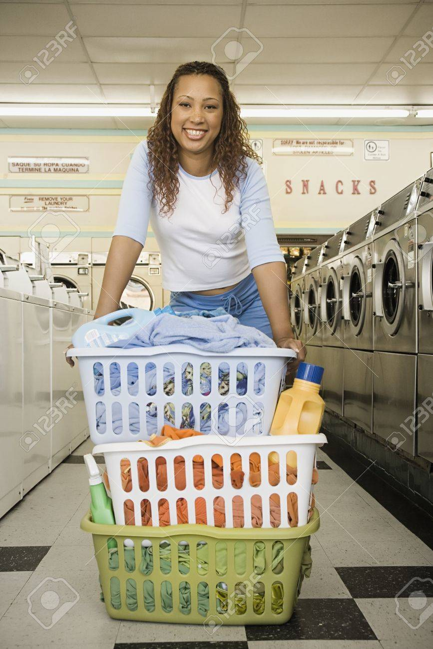 Portrait of woman with baskets of  clothes in laundromat Stock Photo - 16072142