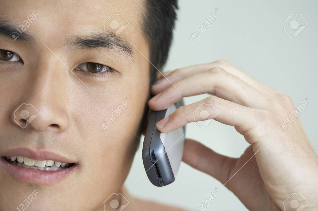 Closeup of young man with mobile phone Stock Photo - 16043301