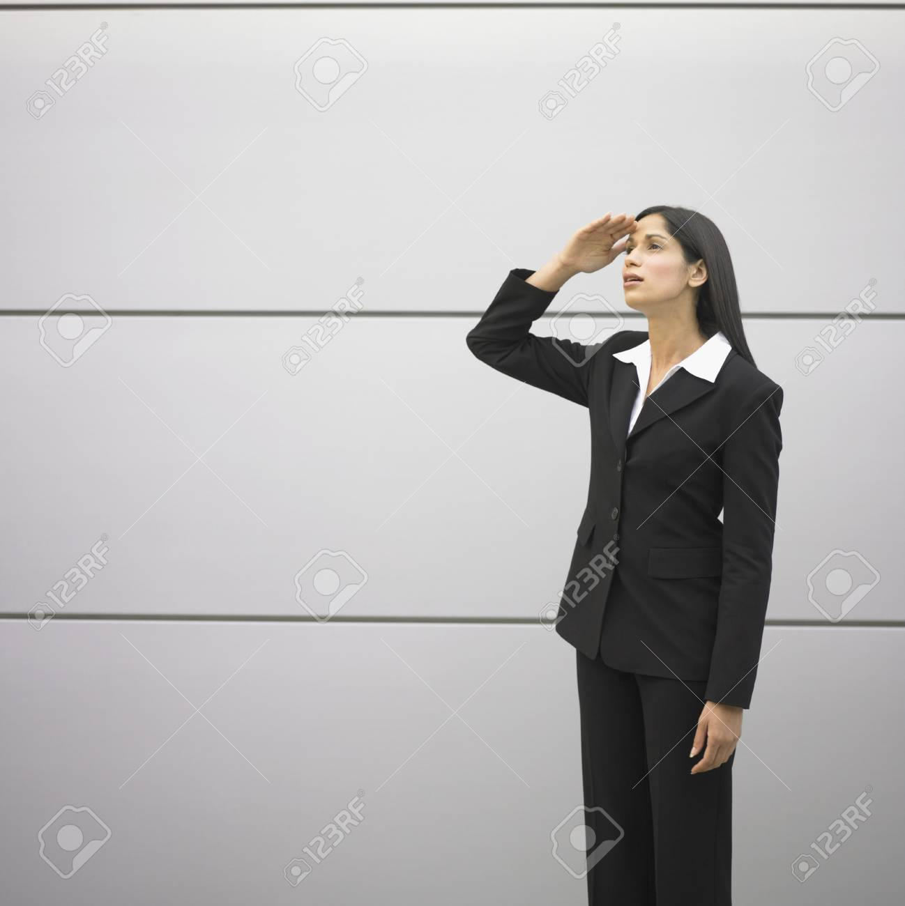 Businesswoman looking up Stock Photo - 16072551