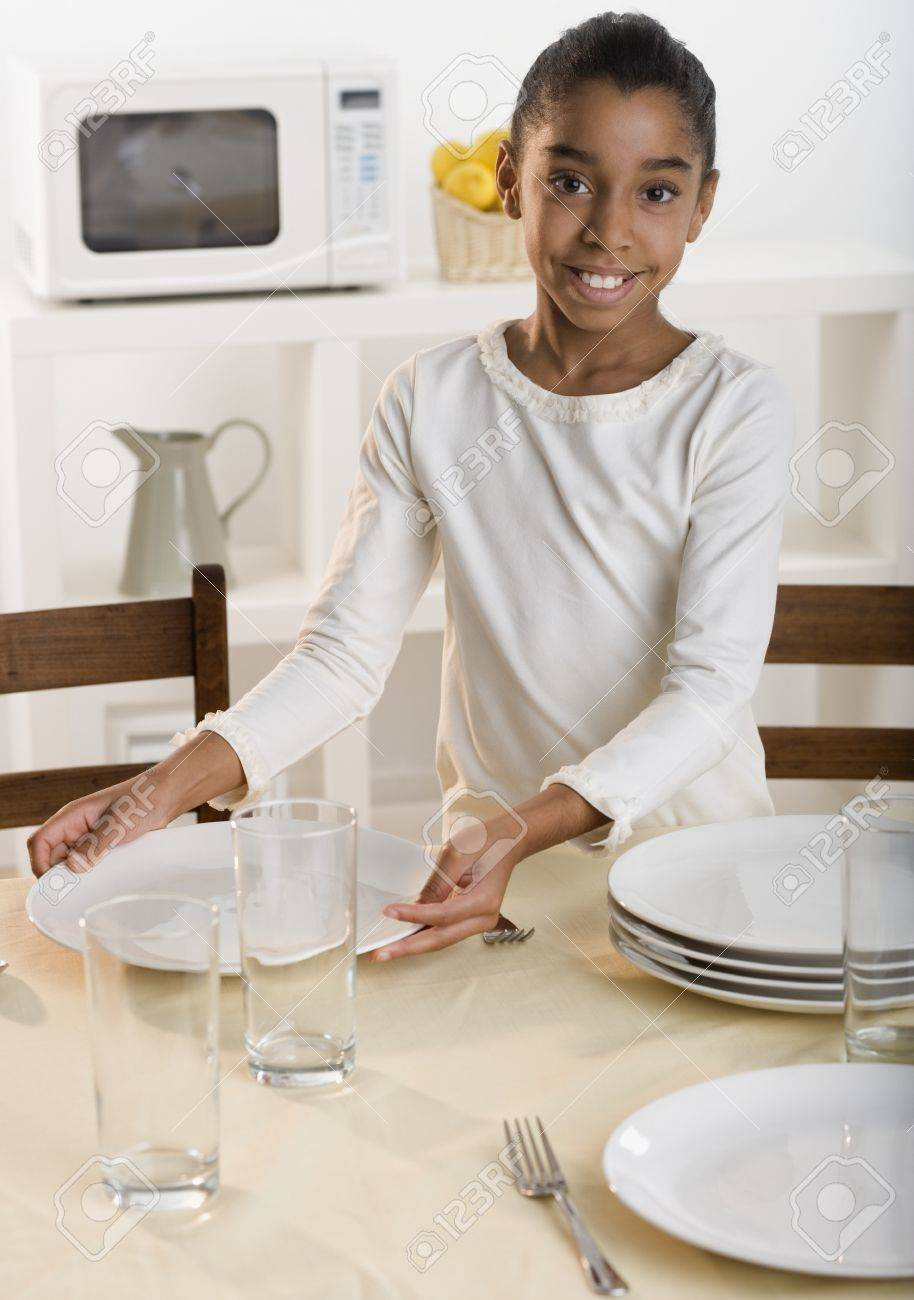 Kitchen Table Setting Girl Setting Kitchen Table Stock Photo Picture And Royalty Free