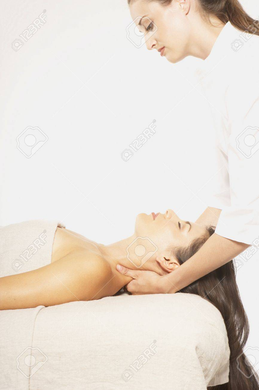 Woman giving another woman massage Stock Photo - 16073116