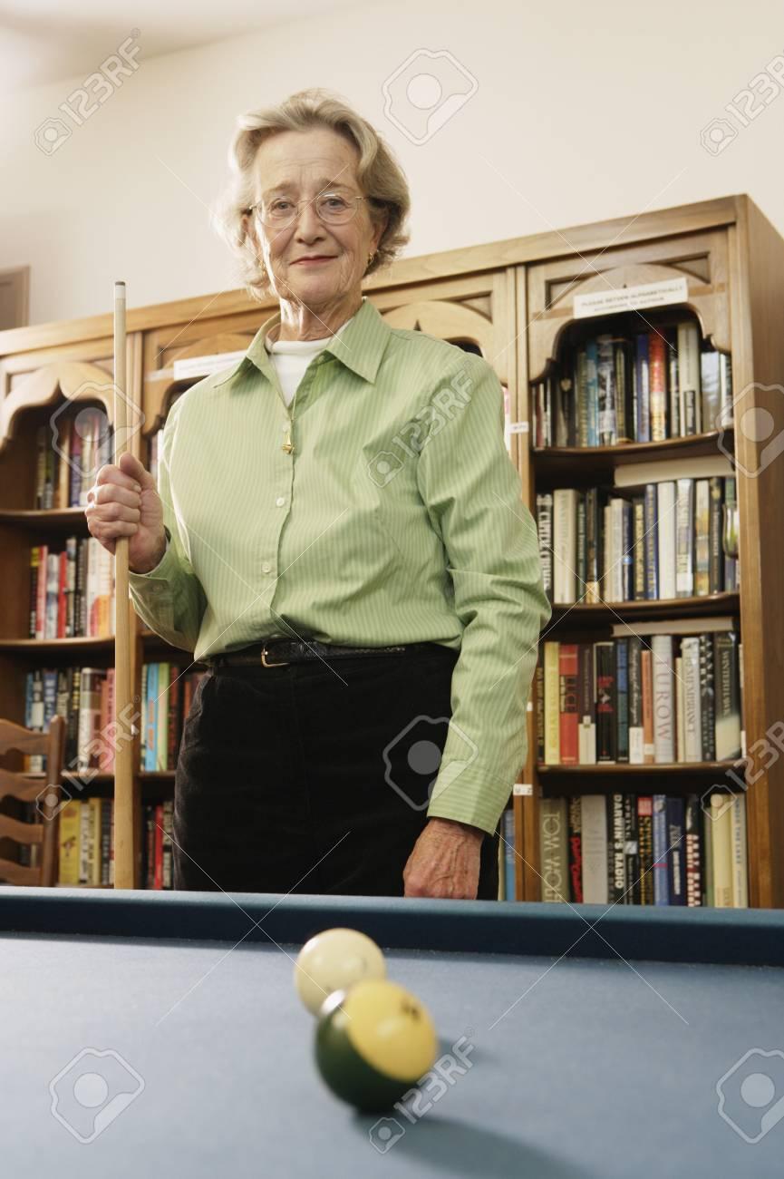 Elderly woman shooting pool Stock Photo - 16073526