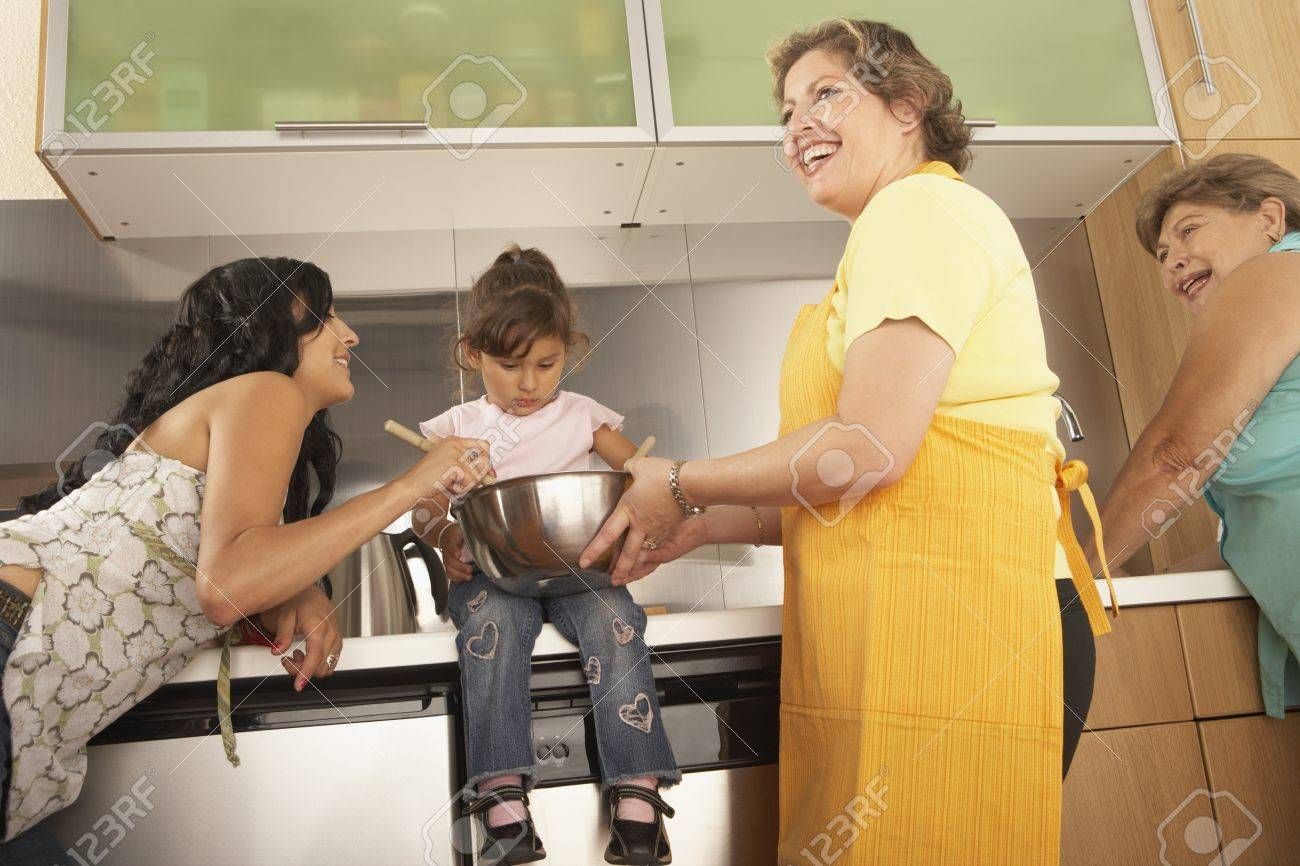Female members of a family cooking together Stock Photo - 16073556