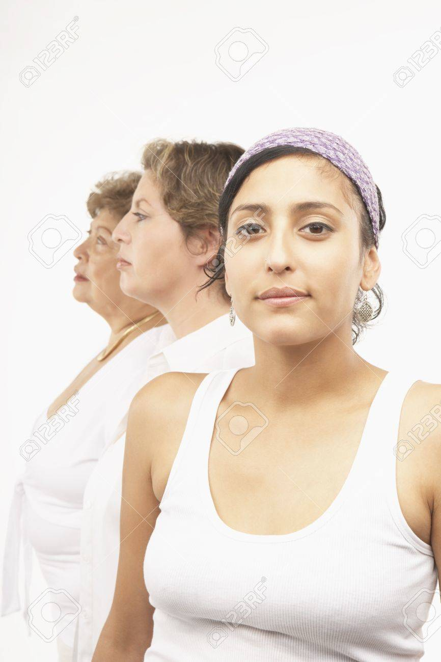 Young woman and other female members of her family posing for the camera Stock Photo - 16073573